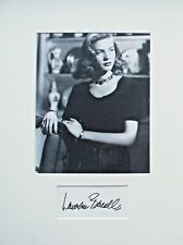 LAUREN BACALL:  Genuinely signed card mounted with photo. Bogart, The Big Sleep.
