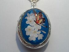SILVER PLATED LOCKET-DEEP BLUE WITH WHITE FLOWER & BEAUTIFUL BROWN BUTTERFLY