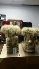 GROOVED SHEARED COYOTE FUR LEG WARMERS WITH POMPOMS