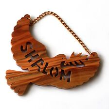 """Olivewood ornament or wall hanging with """"Shalom"""" and a dove."""