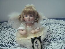 Geppeddo Angel Doll w/attachable wings Item #08B263 Porcelain with hang tag
