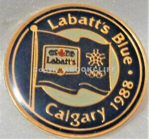 1988 OLYMPICS CALGARY BLUE LABATT'S FLAG SNOWFLAKE SPONSOR Pin