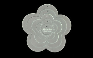 A set of four acrylic flower sewing/craft appliqué templates