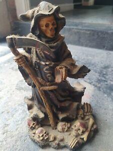Skull figure grin reaper
