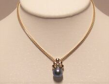 Brand new blue Fresh Water Cultured Pearl Pendant set in 14k solid yellow gold.