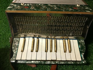 Tonella piano accordion 21 keys 6 chord buttons green gold pearl leather straps