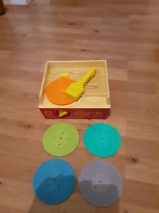 Vintage 1970s fisher price vintage music box record player with 5 records