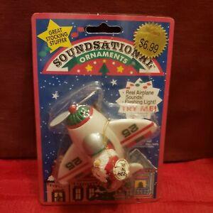 NOS Vintage SOUNDSATIONAL Christmas Ornament ~ SANTA IN A NORTH POLE PLANE