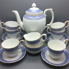 "Crown Staffordshire ""Cameo"" floral & Cherub bone china coffee set - 15 pieces."