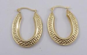 "14K yellow gold ladies oval textured 1"" puffy hoop earrings"