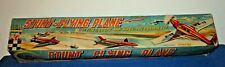 VINTAGE BATTERY OPERATED STUNT FLYING AIRPLANE TOY IOB.