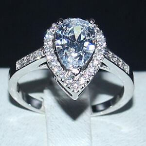 2.79 TCW Pear Cut Moissanite Halo Engagement Ring In 14k White Gold Plated
