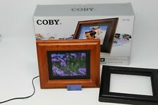 """Coby 5.6"""" Digital Photo Frame w/ MP3 Player  DP-558  New Open Box"""