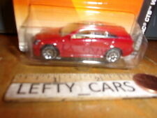 Matchbox Red Cadillac CTS Wagon SCALE 1/64 ON LONG CARD
