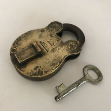 An old solid brass padlock lock with key LION marking LONDON ROYAL PATENT
