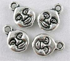 A PACK OF APPROX. 20 ANTIQUED SILVER CHARMS - LITTLE FACE - 7mm.......C131 *