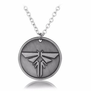 THE LAST OF US DOUBLE SIDED FIREFLY METAL PENDANT NECKLACE. NEW.