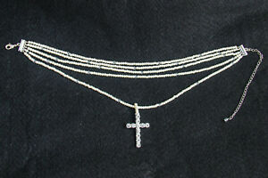 Necklace with crystal cross pendant by Suzie B