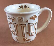 Radio City Rockettes Coffee Mug with gold colored raised design
