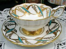ROYAL STAFFORD TURQUOISE ENAMEL & GOLD GILT RIBBONS TEA CUP AND SAUCER