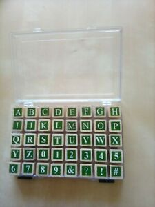 wood mounted rubber stamps in storage box, upper case alphabet & numbers,