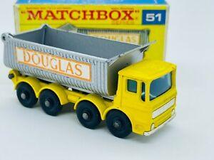 "Matchbox #51 Eight Wheel Tipper Truck, yellow with orange ""Douglas"" labels"