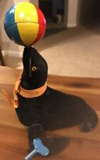 Vintage Mechanical Black Seal with Beach Ball Windup Toy w/ Key