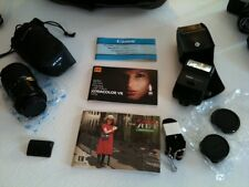 Canon AE-1 Camera with all lens caps, Tokina lens, speedlite 166A, & Accessories