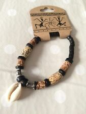 Surfer style black & brown beads with a shell bracelet