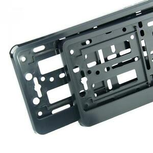 """2 x """"BLACK"""" EFFECT NUMBER PLATE HOLDER SURROUND FOR ANY CAR"""