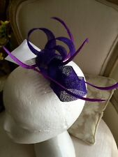 Purple loop fascinator with biot feathers on a comb. Gorgeous on!