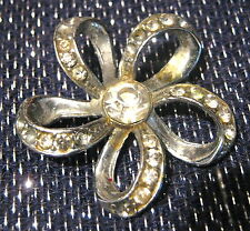 a flower form with white stones Classic Vintage Silver tone brooch in