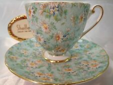 SHELLEY  MARGUERITE CHINTZ  FOOTED RIPON CUP AND  SAUCER #14265  GOLD  TRIM