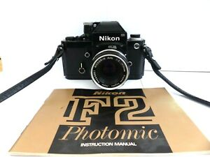 NIKON (Black) F2 PHOTOMIC SLR CAMERA WITH 50MM F/2 NIKKOR  H LENS + MANUAL.