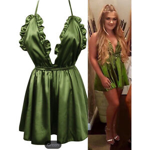 Green satin playsuit with frill detail. True to size. S-XL (8-12).