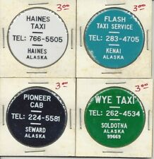 Group of 4 Alaska transit tokens - Soldotna, Seward, Kenai, & Haines