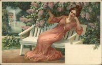v.F. - Beautiful Woman on Park Bench under Lilac Tree c1910 Postcard