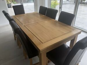 oak extending dining table and 8 chairs