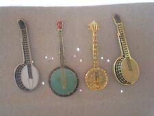 """lot de 4 pins """"banjo"""" (instruments de musique) /reglement par cheque"""