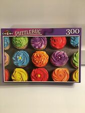 New Puzzlebug 300 Piece Jigsaw Puzzle Bright Colorful cupcakes Baking Sweets NIB
