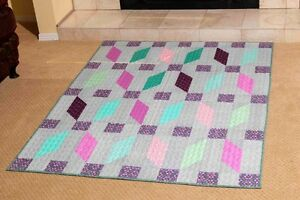 Modern style lap-size quilt in pinks, purples, geen and grey.  Free shipping.