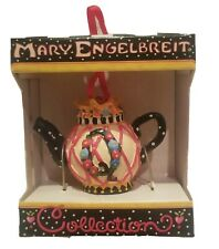 Mary Engelbreit teapot ornament has a Q with a crown on it.