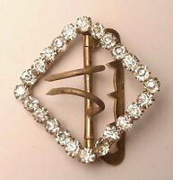 A VICTORIAN GOLD TONE BELT BUCKLE WITH CLAW SET WHITE DIAMANTES