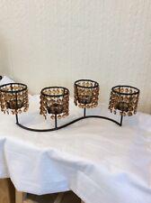 Un supporto metallico marrone con 4 porta tè leggero e Ambra JEWELS