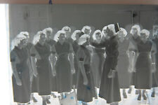 (1) B&W Press Photo Negative Nursing School Women Getting Capped T205