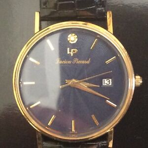 LUCIAN PICCARD 14K SOLID GOLD MENS WATCH.