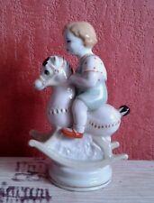 1950s SOVIET POLONNOE ZHK PORCELAIN FIGURINE CUTE BOY ON ROCKING HORSE