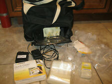 Medela Double Breast pump with accessories and carry bag charger