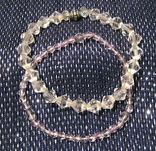 2x elasticated bracelets with clear beads.  Very pretty.