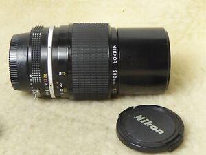 Nikon Nikkor 200mm f/4 AI Man'l Fcs Telephoto Lens. Mint-. + caps front and back